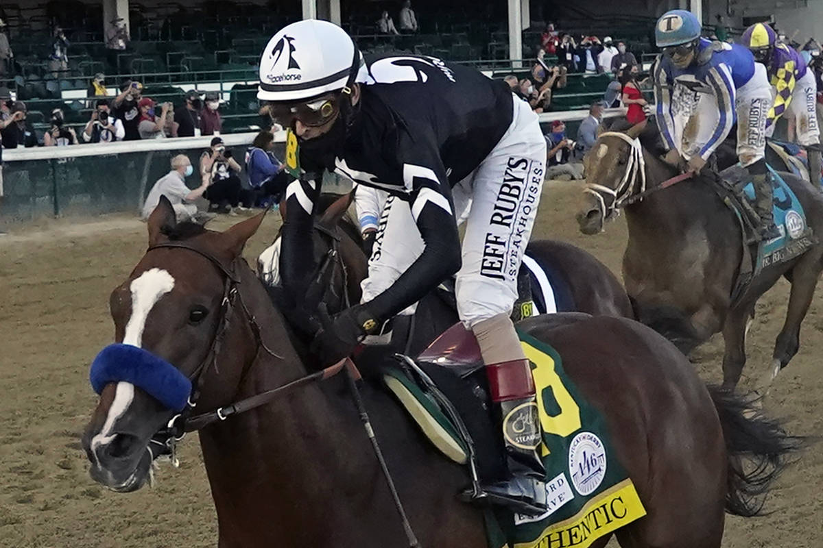 Jockey John Velazquez rides Authentic to win the 146th running of the Kentucky Derby at Churchi ...