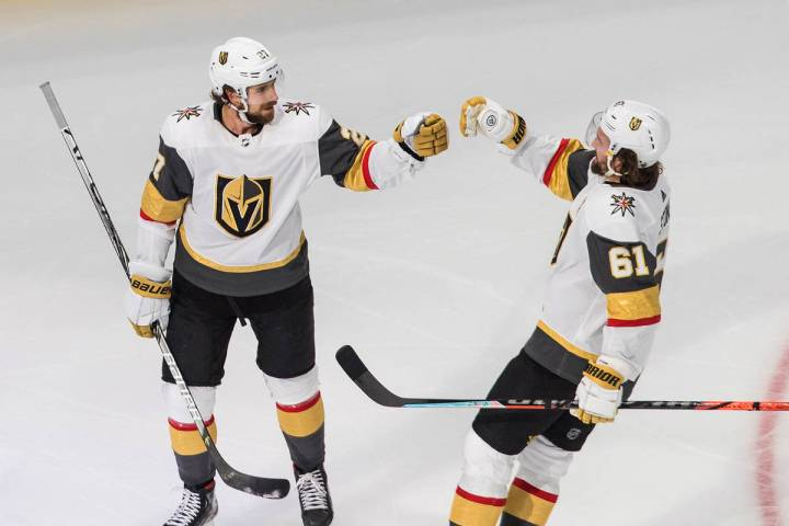 Vegas Golden Knights' Shea Theodore, left, celebrates his goal against the Dallas Stars with Ma ...