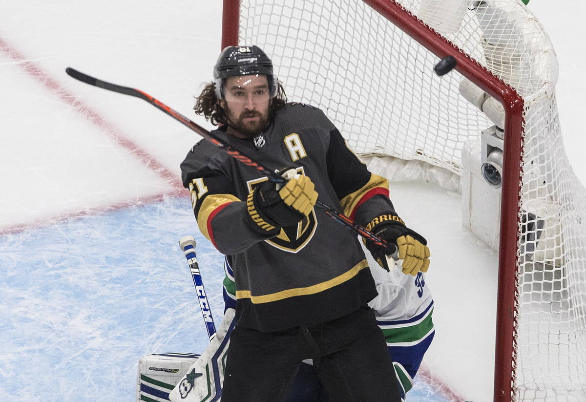 Vegas Golden Knights' Mark Stone (61) tries for the rebound next to Vancouver Canucks goaltende ...