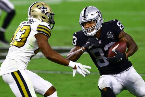 Las Vegas Raiders tight end Darren Waller (83) tries to get around New Orleans Saints free safe ...