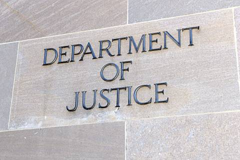 Department of Justice sign, Washington DC. (AP File)