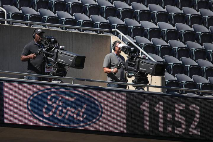 A TV camera crew is seen during the first half of an NFL football game between the Chicago Bear ...