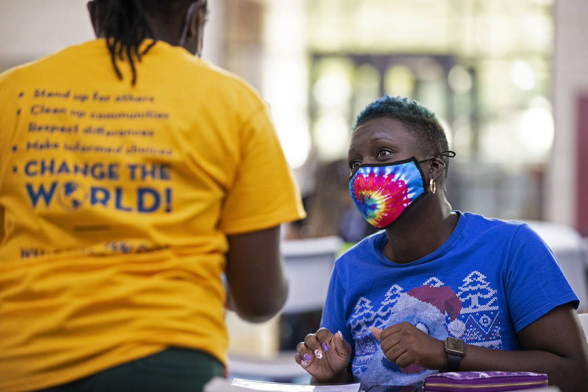 Kanita Carter, right, listens to instructions during a vote drive as part of National Voter Reg ...