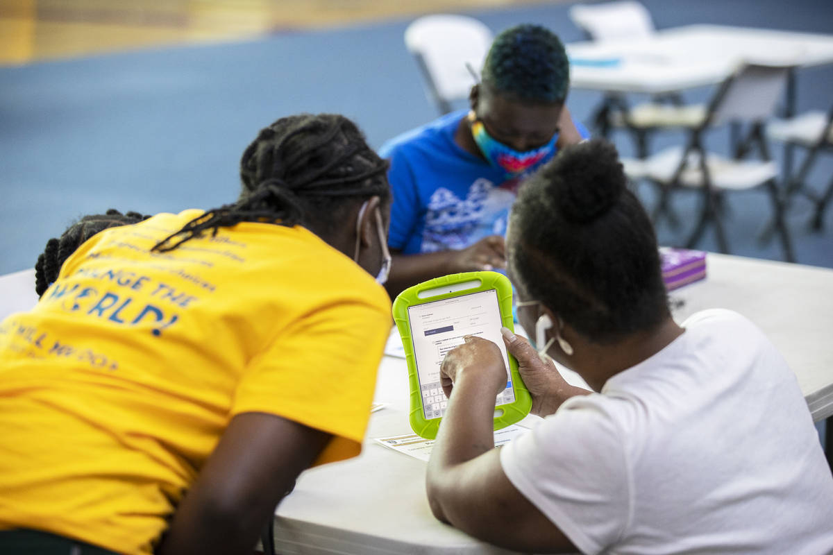 Debra Foster, bottom/right, asks for assistance in registering to vote during a vote drive as p ...