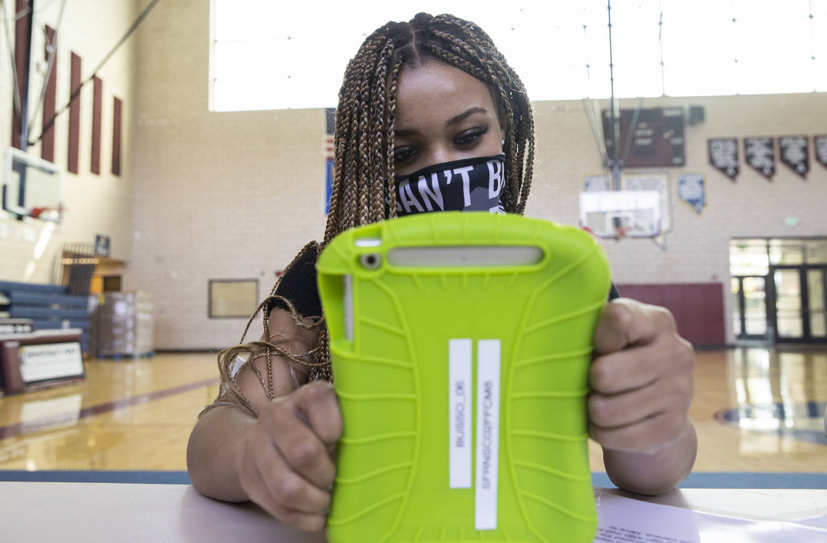 Zuriah Barlow pre registers to vote during a vote drive as part of National Voter Registration ...