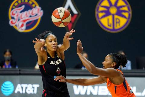 Las Vegas Aces center A'ja Wilson (22) passes the ball in front of Connecticut Sun forward Alys ...