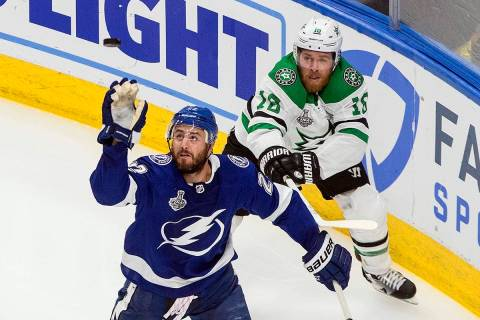 Dallas Stars' Joe Pavelski (16) and Tampa Bay Lightning's Kevin Shattenkirk (22) battle for the ...