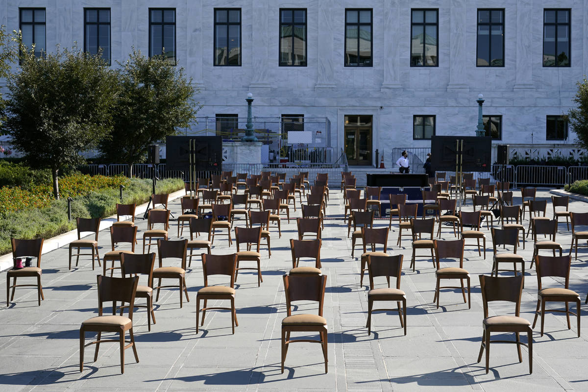Socially-distant chairs sit on a plaza outside the Supreme Court on Capitol Hill in Washington, ...