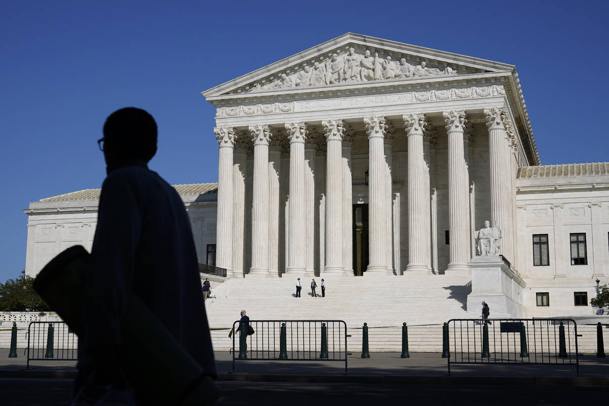 Officials stand on the Supreme Court steps on Capitol Hill in Washington, Tuesday, Sept. 22, 20 ...