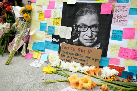 A memorial to U.S. Supreme Court Justice Ruth Bader Ginsburg includes a photograph of the late ...