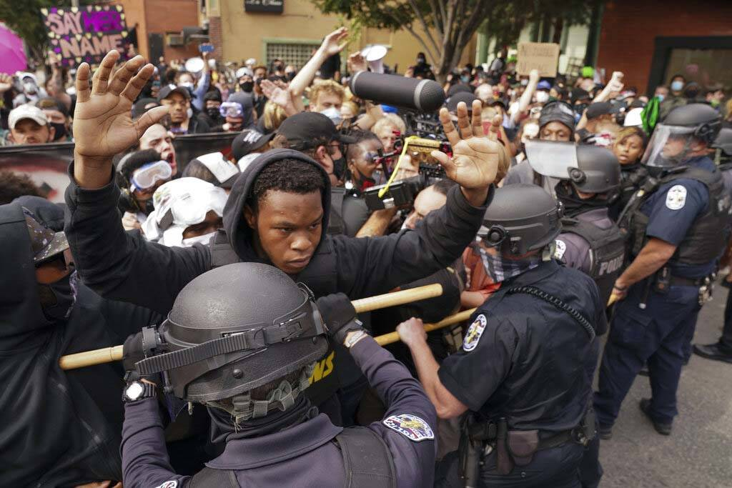 Police and protesters converge during a demonstration, Wednesday, Sept. 23, 2020, in Louisville ...