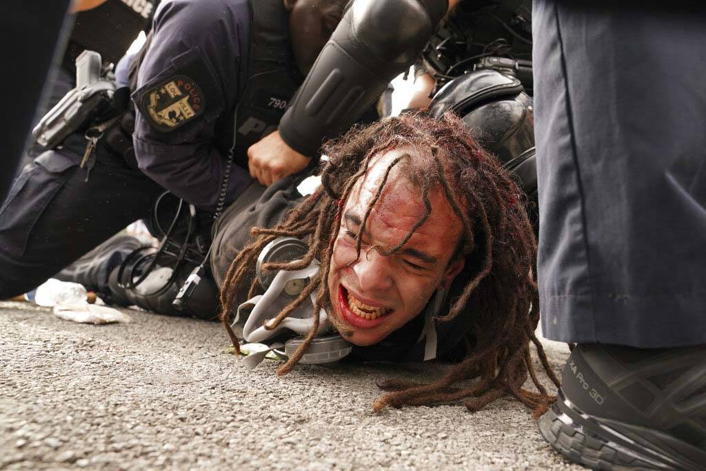Louisville police detain a man after a group marched, Wednesday, Sept. 23, 2020, in Louisville, ...