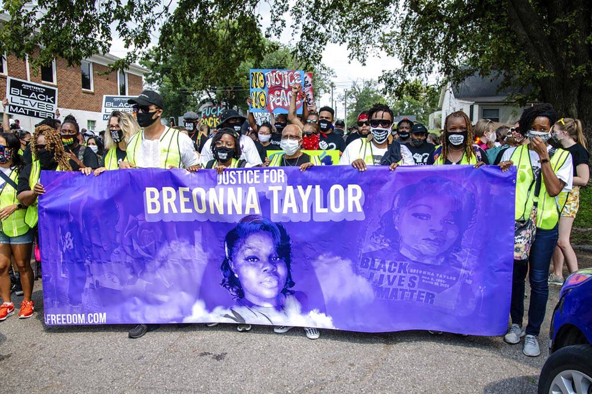 Protesters participate in the Good Trouble Tuesday march for Breonna Taylor, on Tuesday, Aug. 2 ...