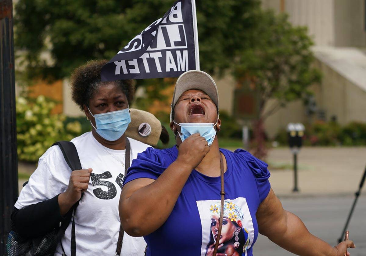 A woman reacts to news in the Breonna Taylor shooting, Wednesday, Sept. 23, 2020, in Louisville ...