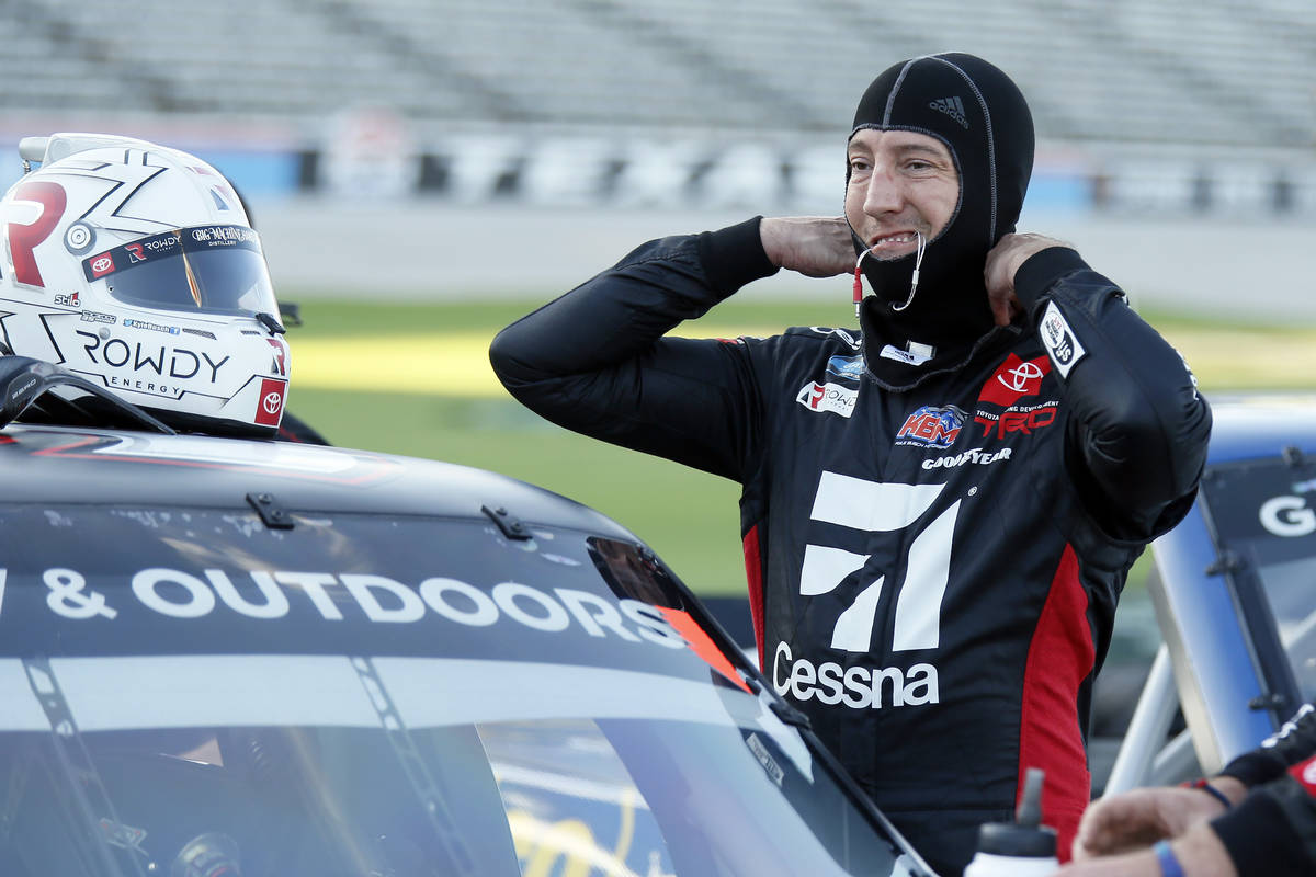 Kyle Busch prepares himself to enter the truck prior the NASCAR Trucks auto race at Texas Motor ...