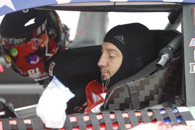 Race driver Kyle Busch preps to drive before the start of the NASCAR Cup Series auto race at In ...