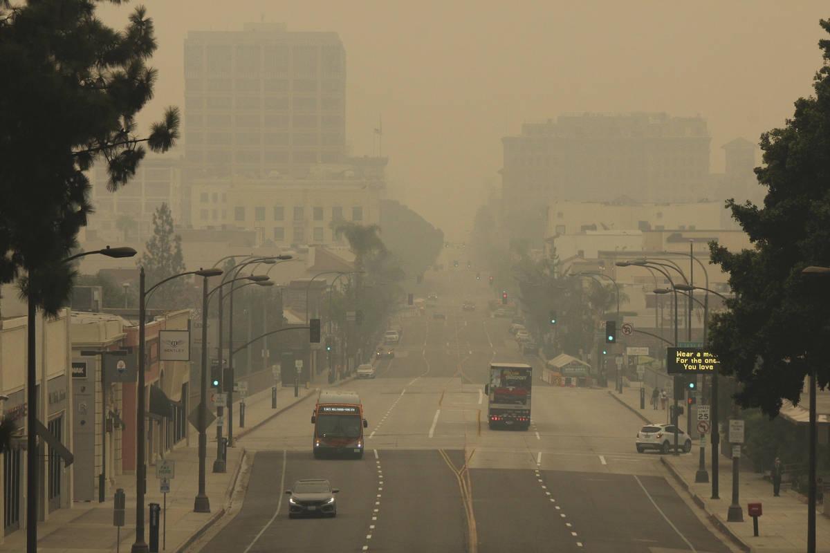 FILE - Smoke from wildfires fills the sky over Pasadena, Calif. (AP Photo/John Antczak, File)