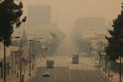 Smoke from wildfires fills the sky over Pasadena, Calif. (AP Photo/John Antczak)
