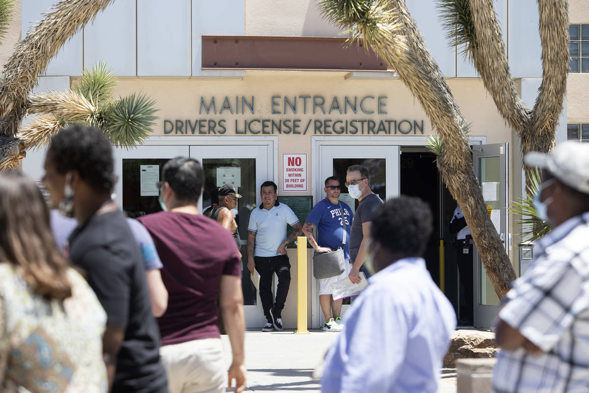 People wait in line at the Nevada Department of Motor Vehicles at 8250 West Flamingo Road, whic ...