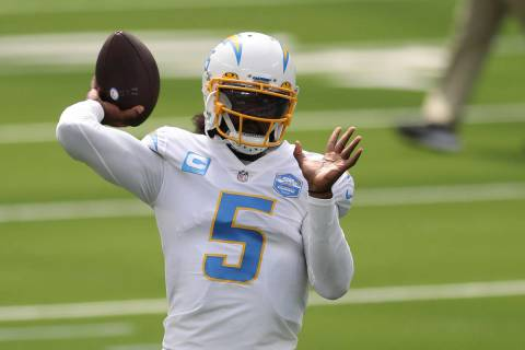 Los Angeles Chargers quarterback Tyrod Taylor (5) warms up before an NFL football game between ...