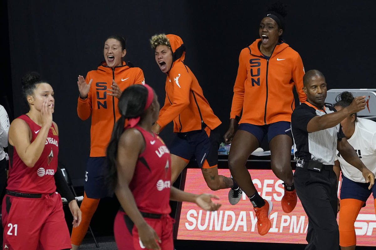 The Connecticut Sun bench celebrates during the second half of Game 3 of a WNBA basketball semi ...