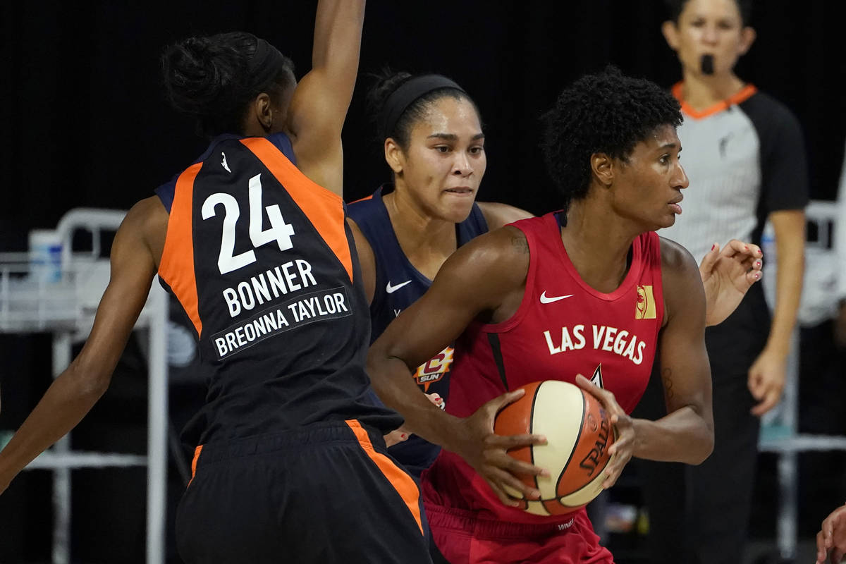 Las Vegas Aces forward Angel McCoughtry (35) looks to pass as she is guarded by Connecticut Sun ...