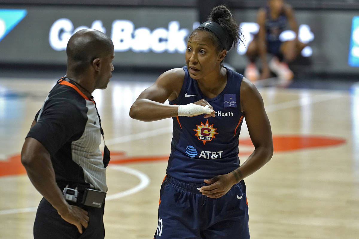 Connecticut Sun guard Briann January (20) argues with an official after she was called for a fo ...