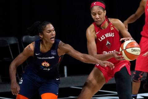 Connecticut Sun forward Alyssa Thomas (25) knocks the ball away from Las Vegas Aces center A'ja ...