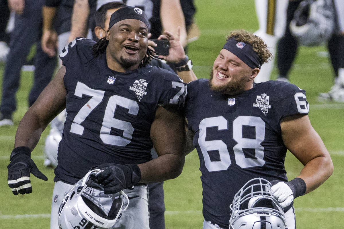 Las Vegas Raiders offensive guard John Simpson (76, left) and offensive tackle Andre James (68) ...