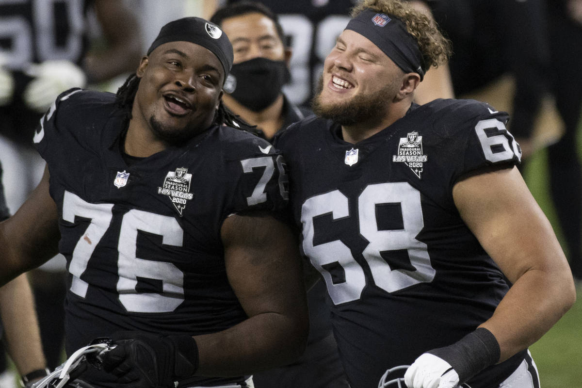 Las Vegas Raiders offensive tackle Andre James (68) celebrates with Las Vegas Raiders offensive ...