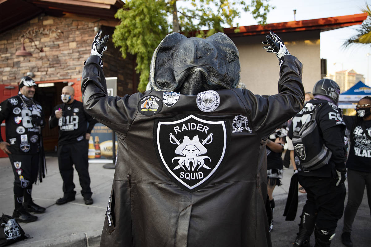 Raiders Squid shows off his jacket at a Raiders party at Tommy Rockers in Las Vegas, Sunday, Se ...