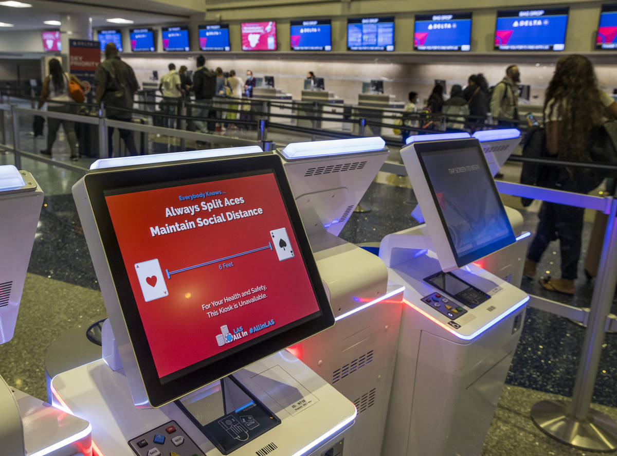 Delta Airlines spaces out working electronic check in machines as COVID-19 safety precautions c ...