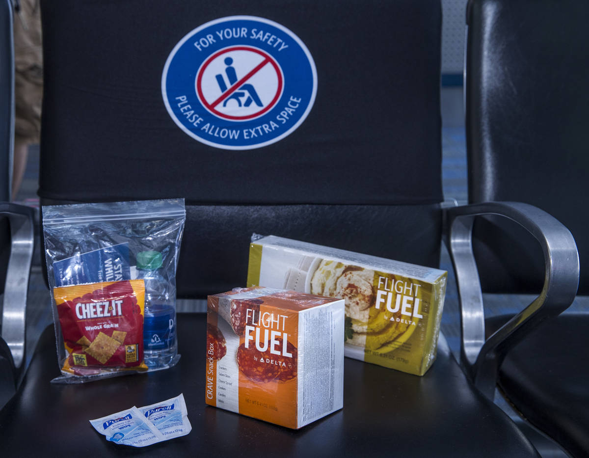 Delta Airlines offers pre-packaged food items as COVID-19 safety precautions are for flights de ...