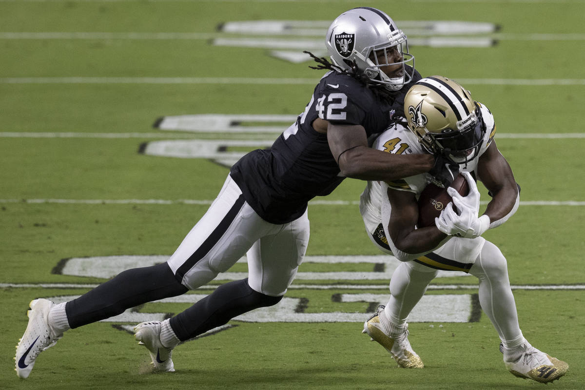 Las Vegas Raiders inside linebacker Cory Littleton (42) tackles New Orleans Saints running back ...