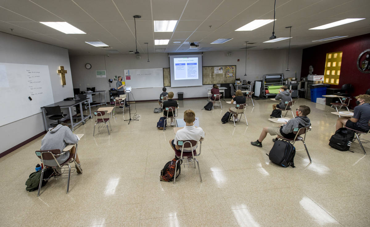 Students keep socially distanced while attending Joel ArnoldÕs world history class at the ...