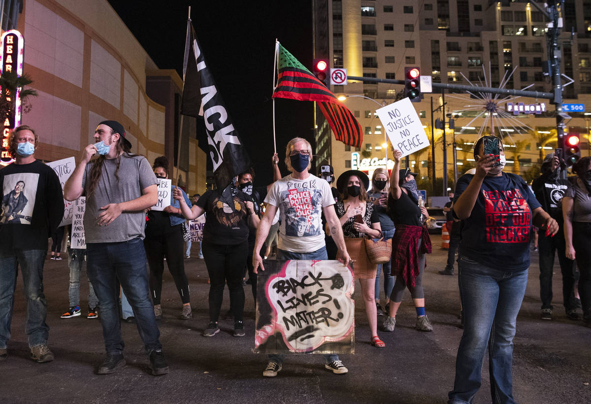 Protesters, calling for justice in the shooting death of Breonna Taylor, block Las Vegas Boulev ...