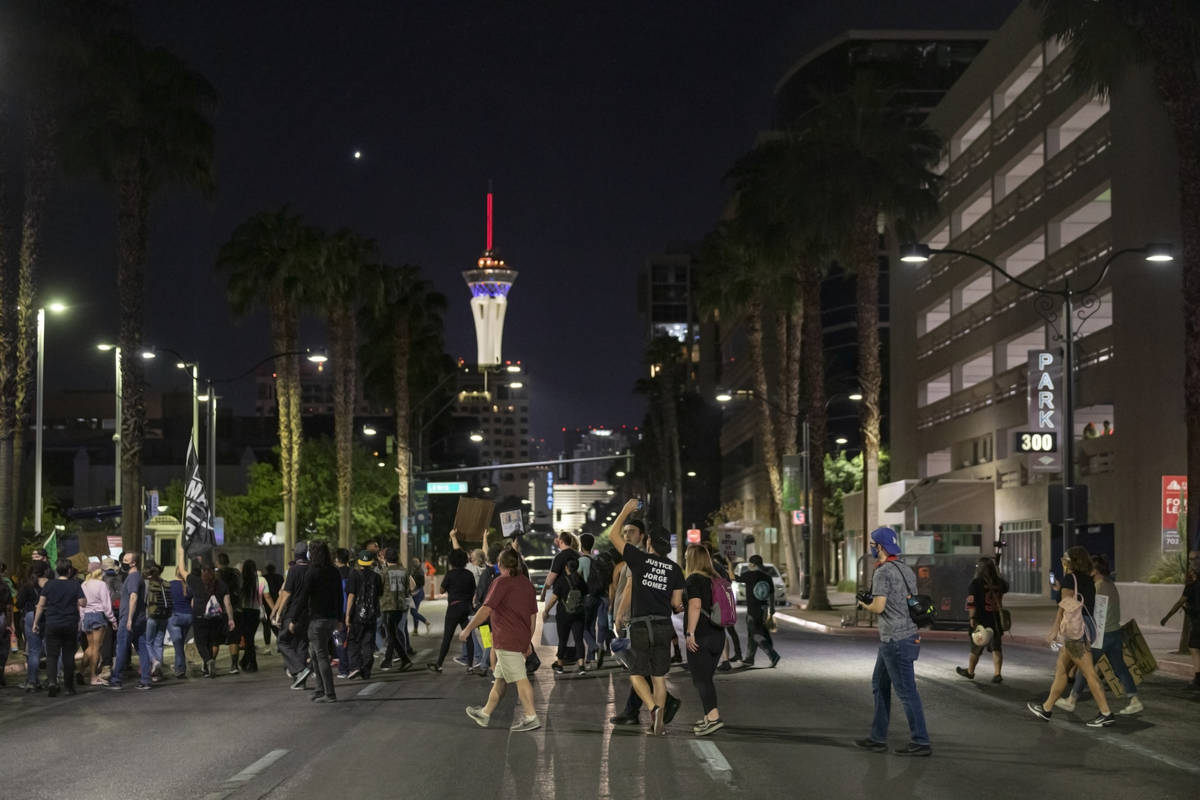 Demonstrators cross Las Vegas Blvd., while protesting in honor of Breonna Taylor, in downtown L ...
