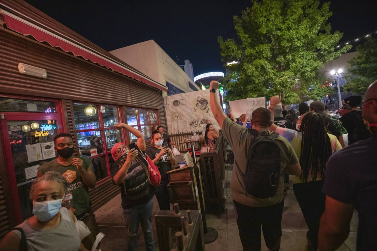 Demonstrators walk down Fremont Street in honor of Breonna Taylor, in downtown Las Vegas on Wed ...
