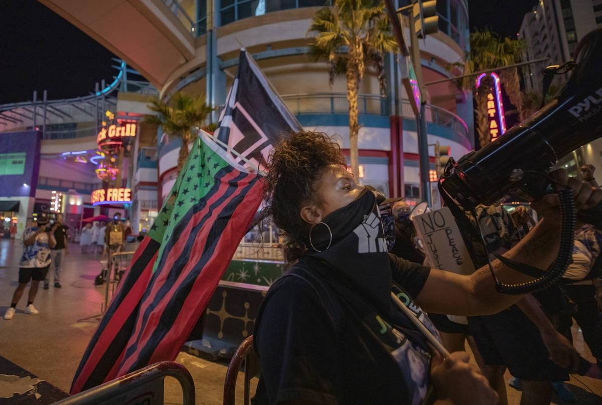 Demonstrator Sierra McDaniel, 24, of Las Vegas, leads protesters in honor of Breonna Taylor on ...