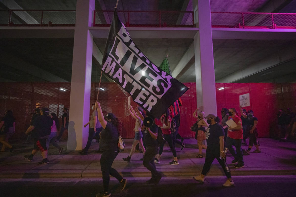 Demonstrators protest on Las Vegas Blvd., in honor of Breonna Taylor in downtown Las Vegas on W ...