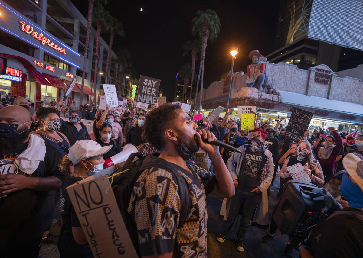 Protester Gary House, 28, of Las Vegas, leads chants in honor of Breonna Taylor on Las Vegas Bl ...