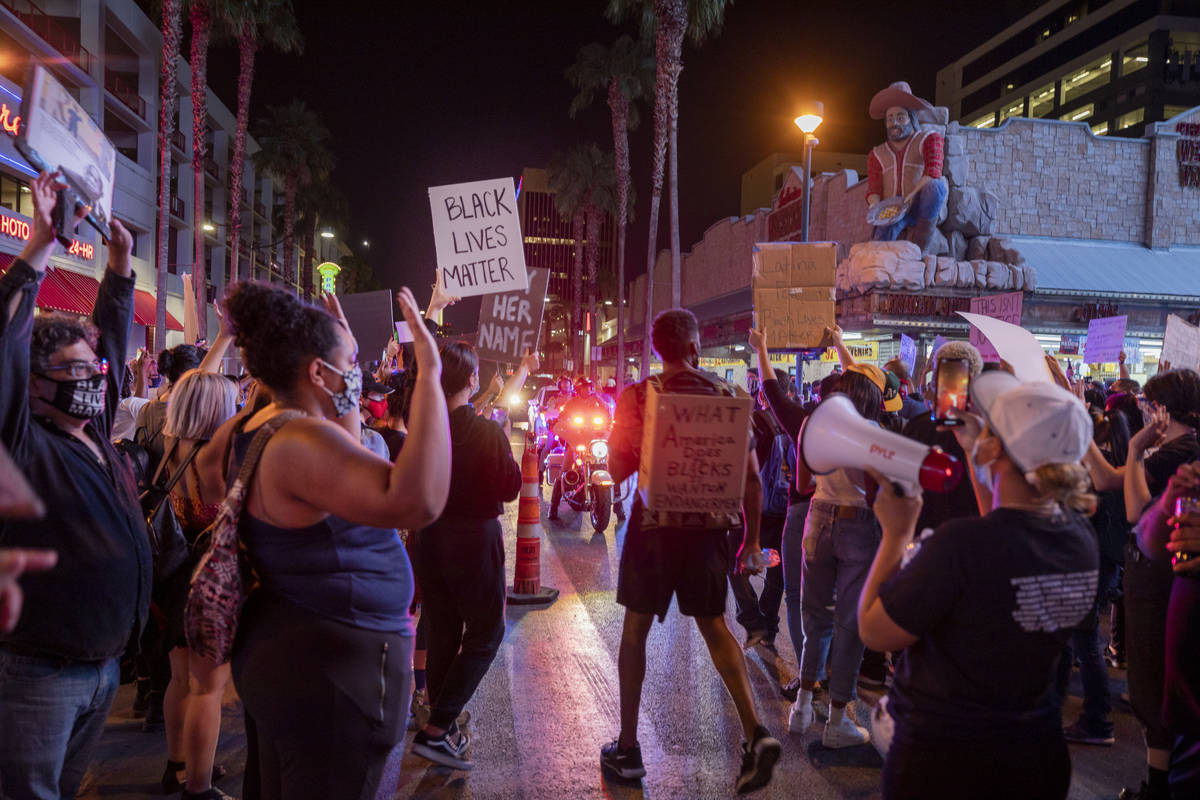 Law enforcement arrives as protesters demonstrate in honor of Breonna Taylor on Las Vegas Blvd. ...