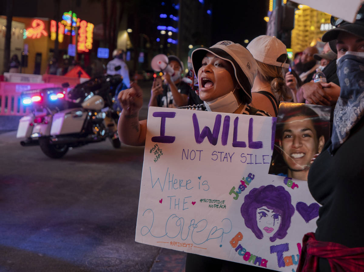 Demonstrator Sophia Sorn, 24, of Las Vegas, yell at law enforcement while protesting for Breonn ...