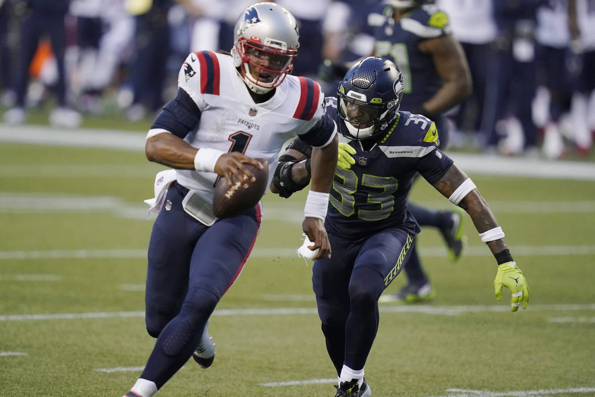 Seattle Seahawks strong safety Jamal Adams (33) closes in on a sack of New England Patriots qua ...