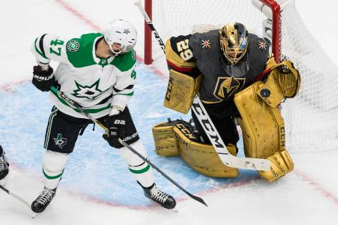 Vegas Golden Knights goalie Marc-Andre Fleury (29) makes a save on Dallas Stars' Alexander Radu ...