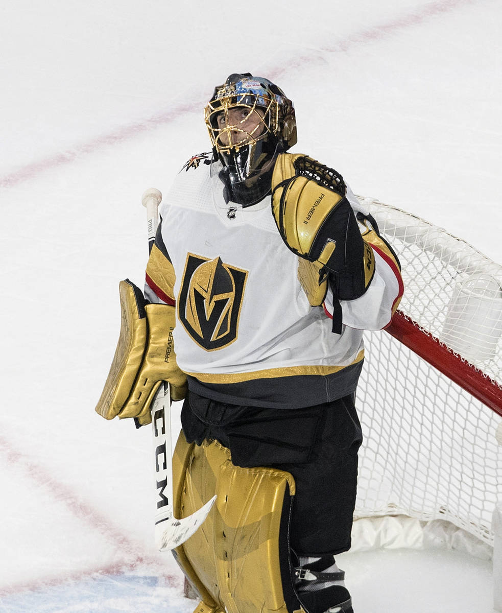 Vegas Golden Knights goalie Marc-Andre Fleury (29) reacts to the win over the Chicago Blackhawk ...