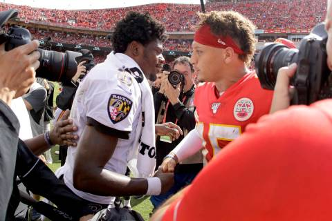 Kansas City Chiefs quarterback Patrick Mahomes, right, and Baltimore Ravens quarterback Lamar J ...