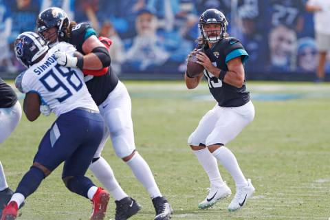Jacksonville Jaguars quarterback Gardner Minshew (15) passes against the Tennessee Titans in th ...