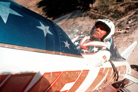 Evel Knievel sits in a steam-powered rocket motorcycle at Snake River Canyon in Twin Falls, Ida ...