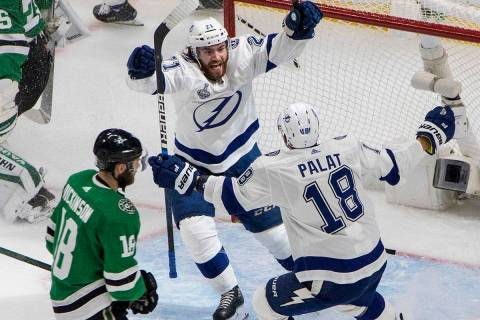 Tampa Bay Lightning center Brayden Point (21) celebrates his goal with Ondrej Palat, right, as ...
